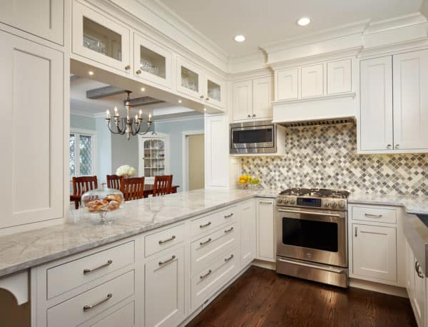 highlight your stainless appliances with all-white cabinets and mosaic tile backsplash