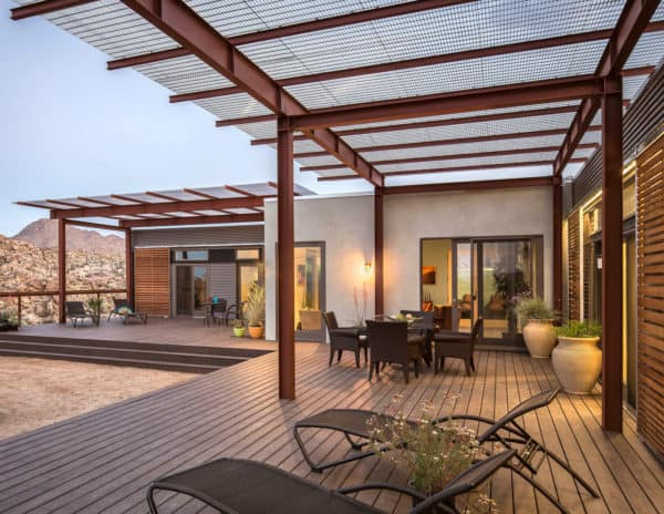 try a metal seam roof for the ultimate contemporary style pergola over a laidback deck