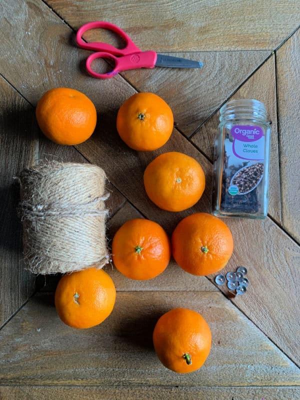 supplies to make a clove studded orange pomander ball