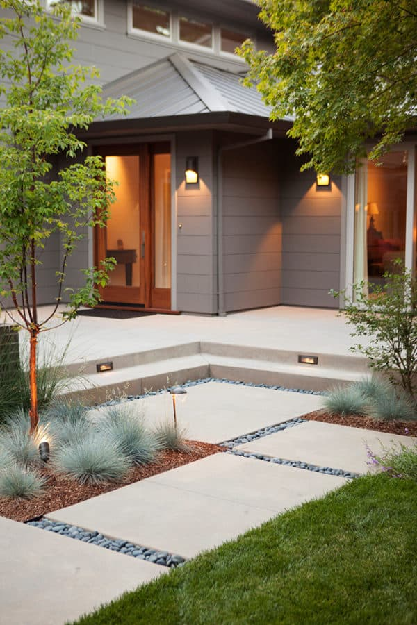 concrete path and front steps with yellow illumination can evoke an exquisite and trendy house design