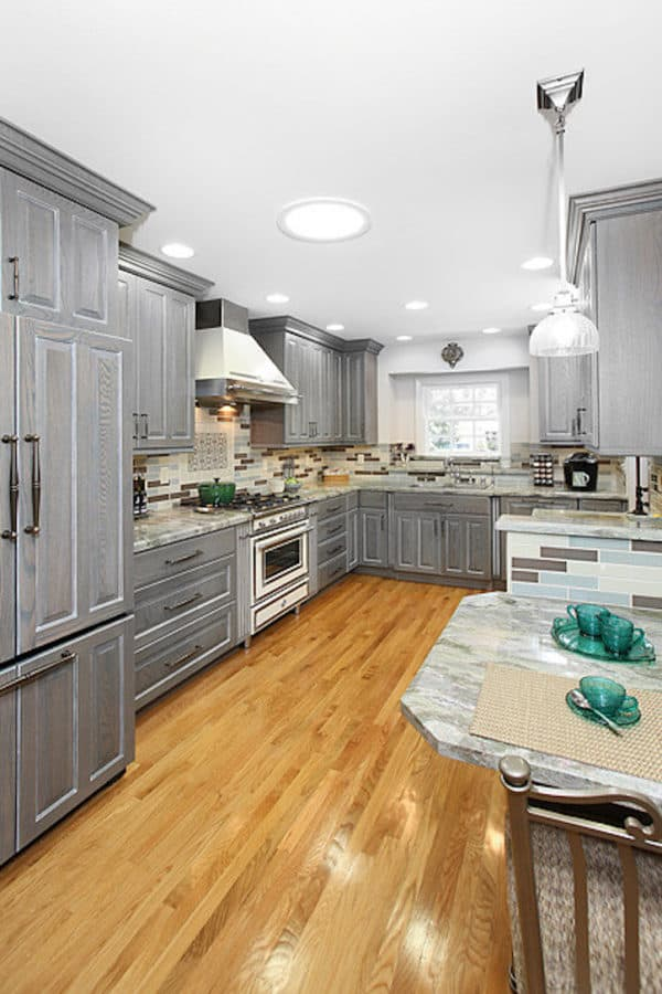 try grey-stained cabinets and rare granite countertops for an english cottage-inspired kitchen