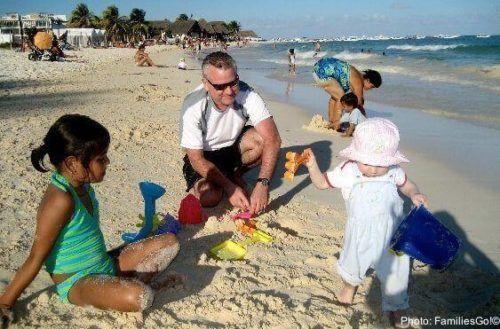 Little kids play on the beach in playa del carmen