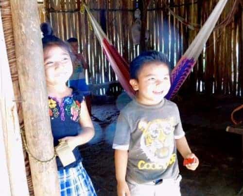 Kids saying hello in their mayan village