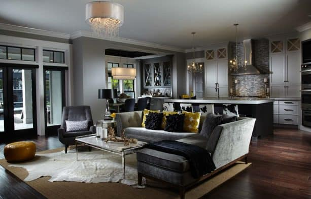 dark grey living room with accentuating mustard cushions