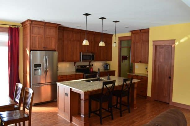 covering the space between kitchen cabinets and ceiling with craftsman crown molding