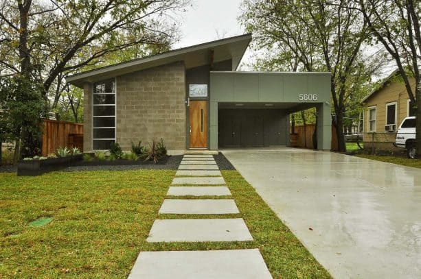 a carport attached to two sides of a midcentury house