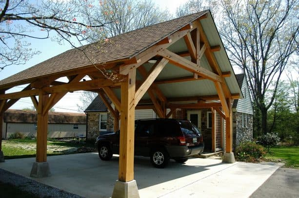 an amazing, handcrafted timber carport addition in a craftsman house facade