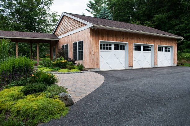the farmhouse 3-car garage that is connected to the main house with a simple walkway