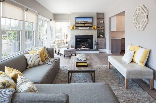 grey and mustard living room with bright natural light