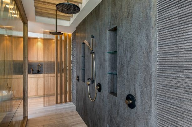 an open contemporary shower room with Lava Rock solid wall panels