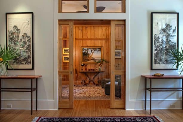a contemporary wooden pocket doors with white trim