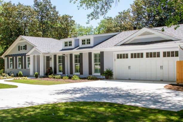 light grey brick ranch house exterior paired with grey shutters and white trim