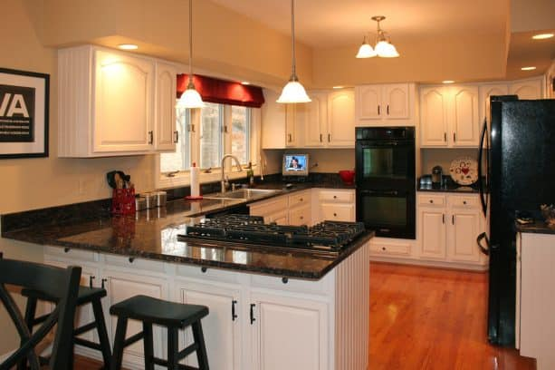 a classic look obtained after the cabinets get a new white paint