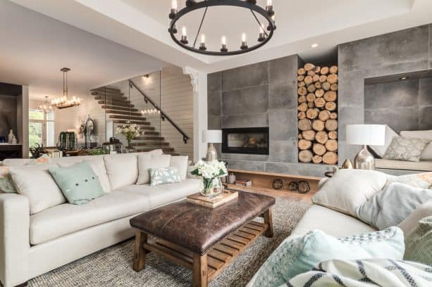 a farmhouse industrial living room interior with wall-size unfinished concrete fireplace