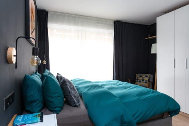 the room is dominated with muted black color from the walls