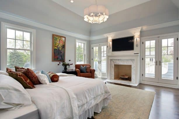 contemporary master bedroom with Benjamin Moore Pebble Beach 1597 wall paint color