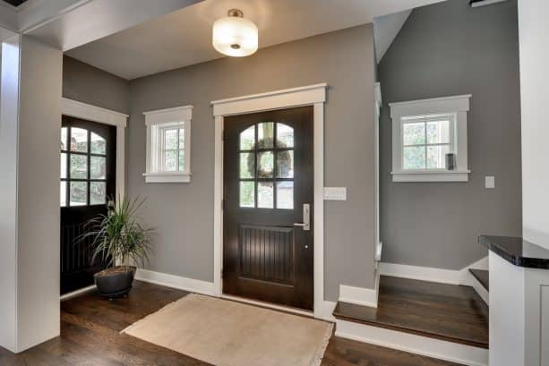 traditional entryway with Sherwin-Williams pavestone SW 7642 wall paint color