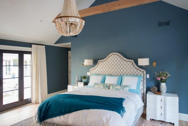 a bedroom with teal and white theme