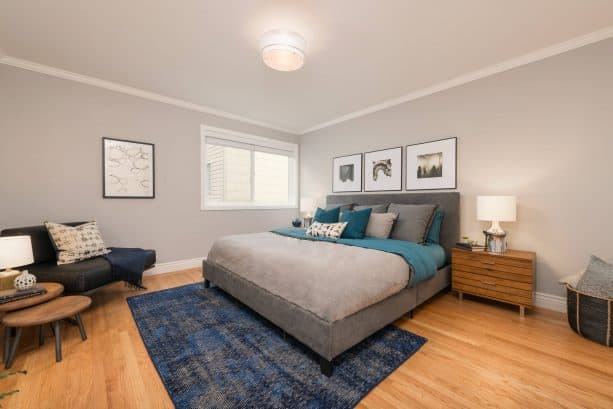 a bedroom with teal, cobalt blue, and grey theme