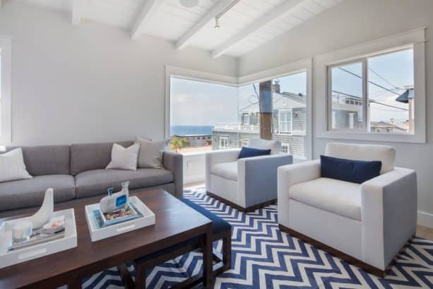 beach-style grey and blue living room with white and denim blue chevron rug
