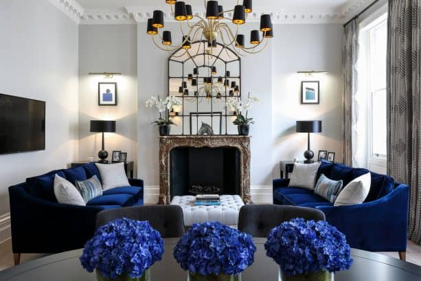grey and blue living room with velvet navy blue sofa