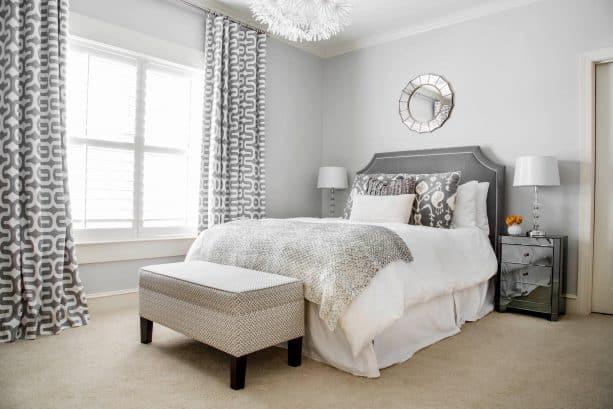 grey and white bedroom with beige carpet floor