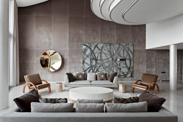 grey and brown living room with a wall from acoustic fabric panel