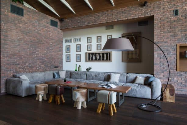 grey and brown living room with sectional and ottomans