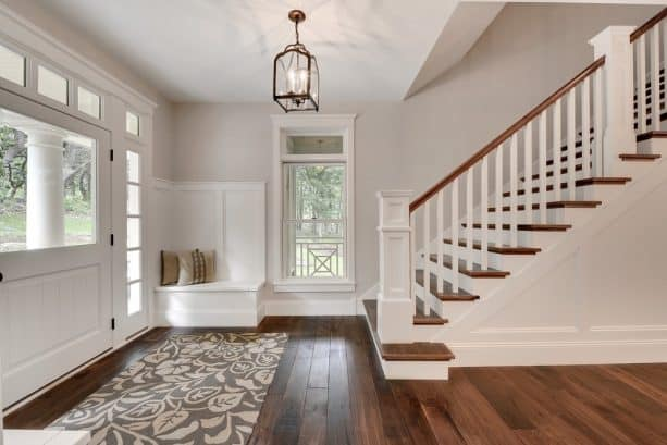 transitional entry with grey paint and walnut floor