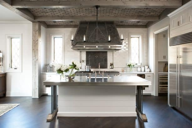 a transitional kitchen with ceiling covered in thin bricks