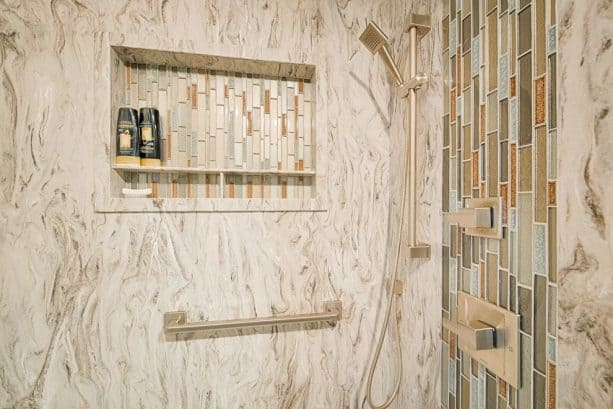 solid surface paired with mosaic tile in shower wall design
