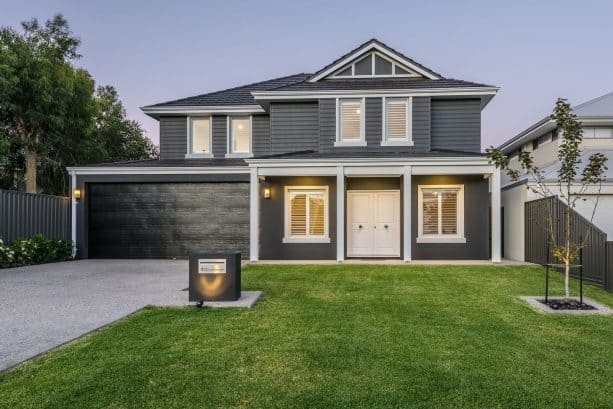 a dark grey house with charcoal roof