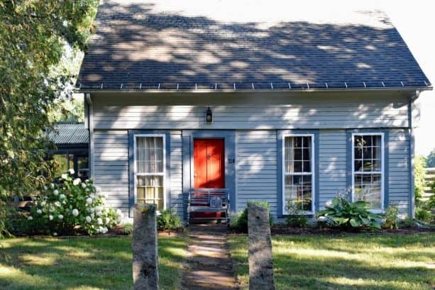 a slate blue house with crimson red door