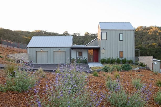 a warm two-tone farmhouse exterior with Sage Mountain 1488 and Winterwood 1486 colors