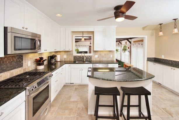 contemporary kitchen with white cabinets and beige wall paint color