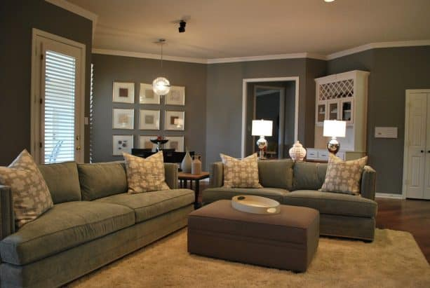 grey and brown living room with suede couches and upholstered table