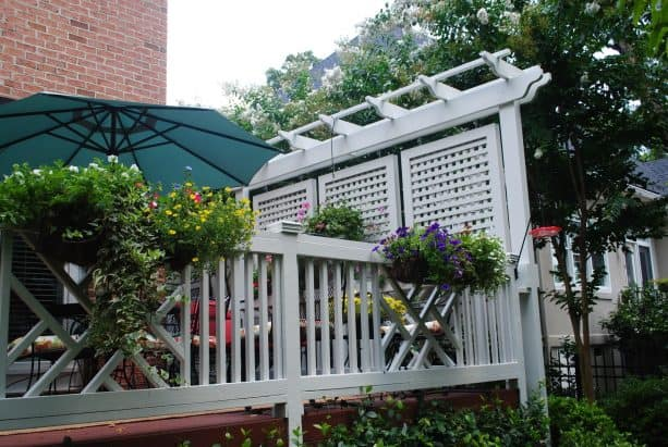 a special frame built behind the railing to hang the privacy screens