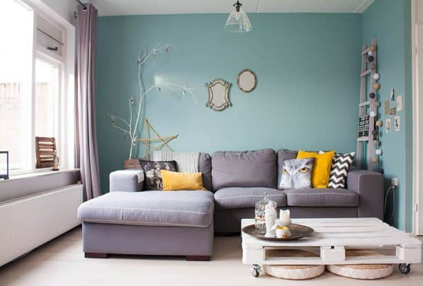 grey and mustard living room with mint accent wall