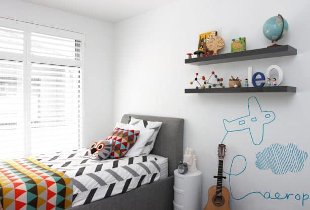 gray and red bedroom for a younger boy