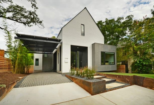 a minimalist black attached carport in floating design
