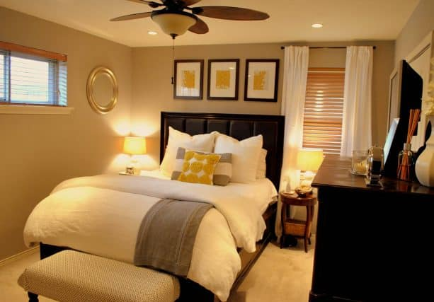 an inviting bedroom with grey, yellow, and black color scheme