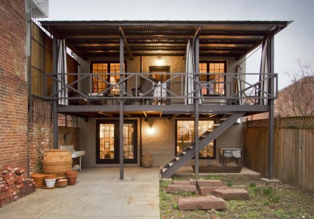 an industrial-style terrace with brick wall and corrugated metal roof