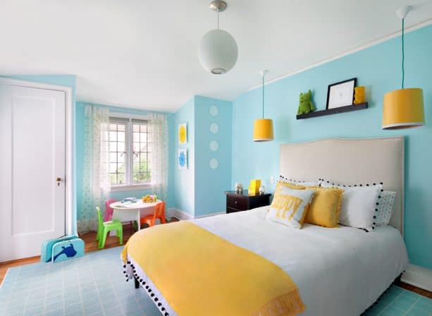 grey and yellow bedroom with a bright blue wall