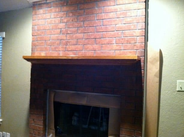 before makeover floor to ceiling red brick fireplace