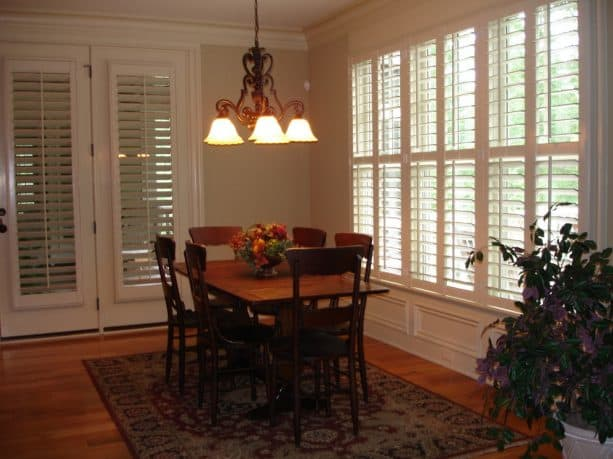 white plantation shutters that cover only the glass parts of the French doors