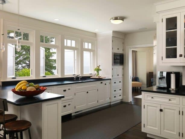 traditional kitchen with antique white cabinets and black granite countertops