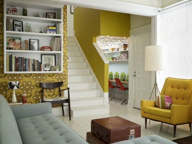 eclectic grey and yellow living room with corn yellow floral wall