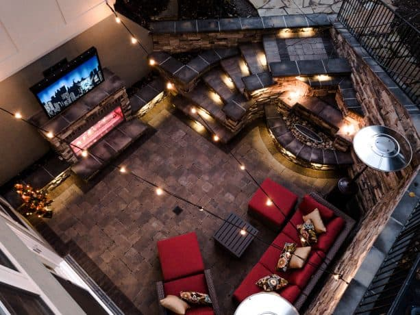 a modern walkout basement patio with complete features and gorgeous lighting