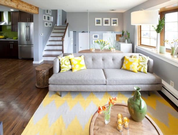 living room with chevron-patterned grey and yellow rug