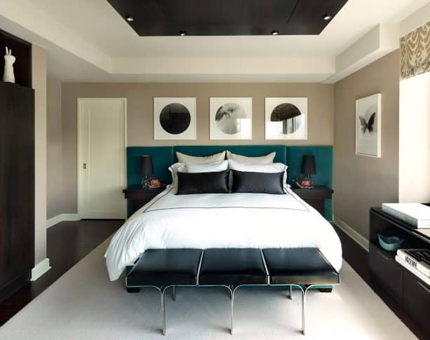 a contemporary velvet bed looks accentuating with its teal color that is pair with the black furniture